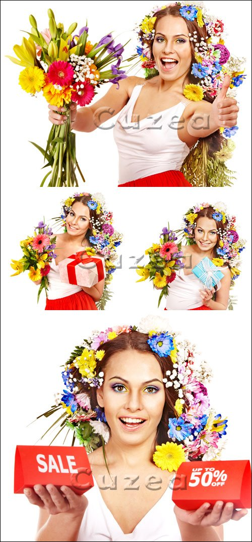 Девушка с цветами и подарками - Stock photo