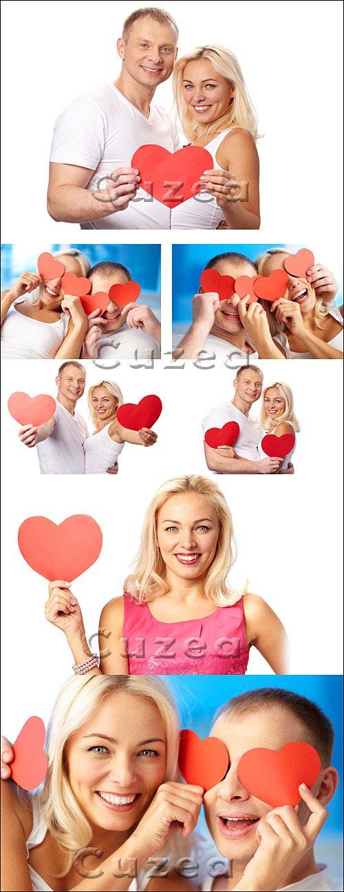 Влюбленная пара с сердцами на белом фоне - Stock photo