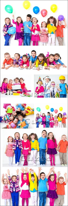 Дети в цветной одежде на белом фоне/ Children in color clothes on a white background - Stock photo