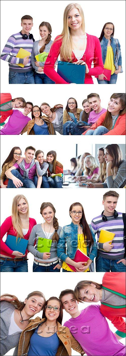 Группа молодых студентов на белом фоне/ Young group of students - Stock photo
