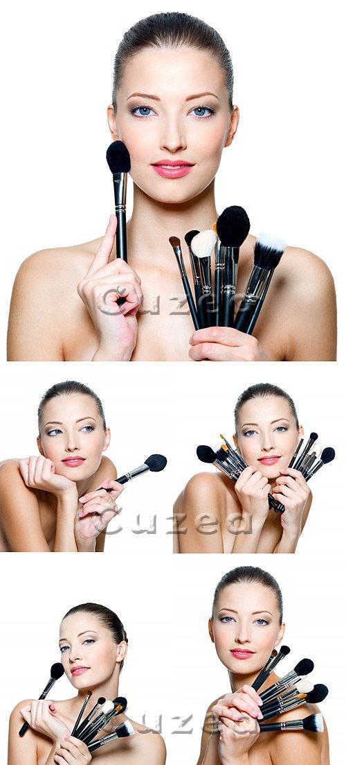 Девушка c кистями для макияжа / Beautiful young woman holding make-up - stock photo