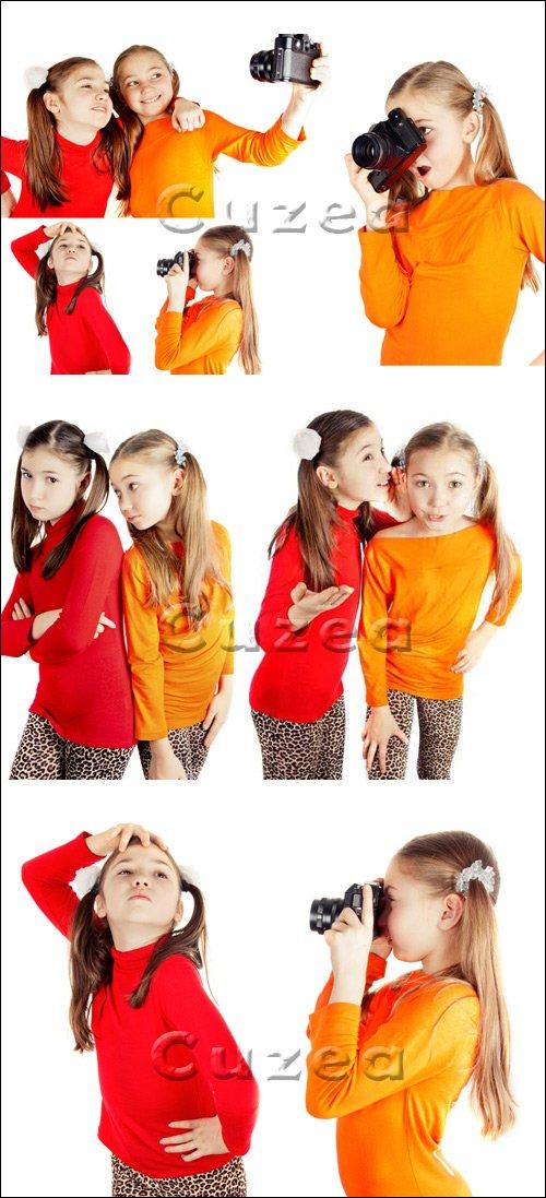 Девочки с фотокамерой / Girls with photo camera - stock photo