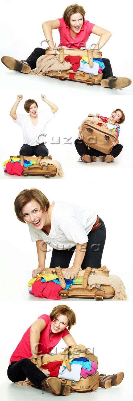 Девушка с чемоданом / Girl with suitcase - stock photo