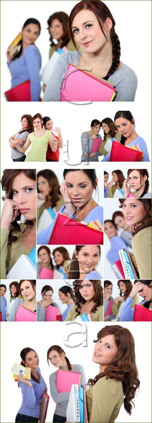 Молодые девушки-студентки / Young female students on white - stock photo