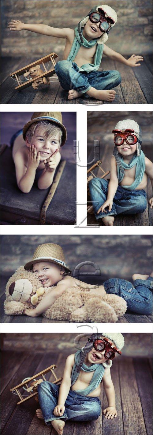 Малыш с аэропланом / Small boy with plane - stock photo