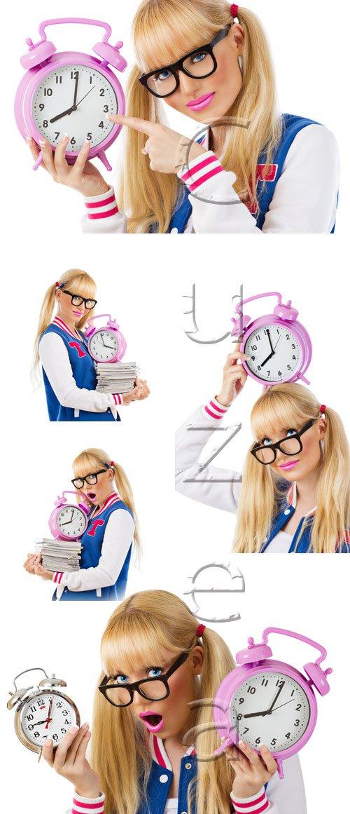 Прелестная студентка с будильником / Beautiful student girl with clock - stock photo