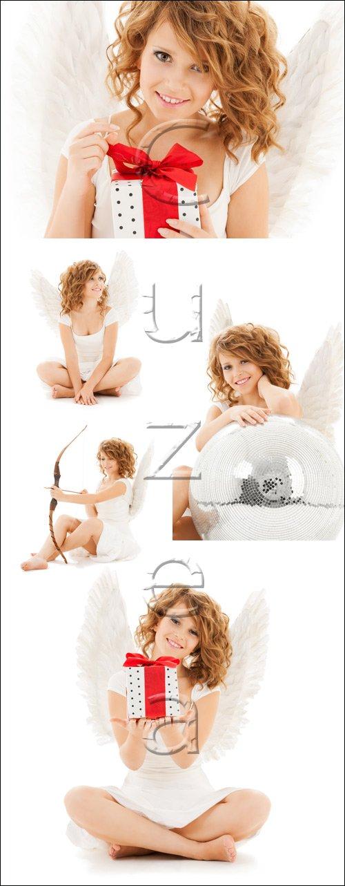 Teenage angel girl with christmas gift - stock photo