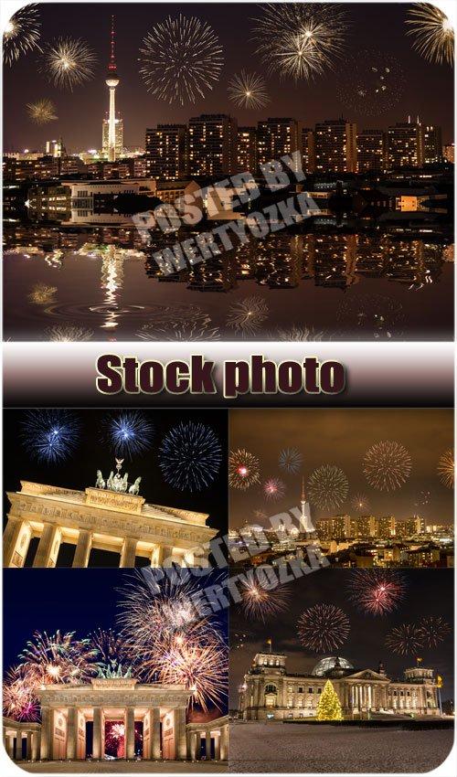 Праздничные салюты над ночным городом / Celebratory fireworks over night city - stock photos
